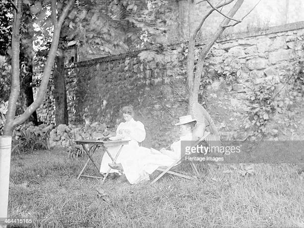 Somerville College Woodstock Road Oxford Oxfordshire 1895 Two young ladies presumably students sit at a table in the college gardens One appears to...