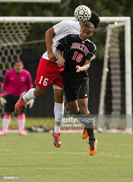 Somerville High's Jonathan Figueroa getting airborne with Brockton High Kevin Fortes during first half action at Dilboy Stadium on Monday Sept 9 2013