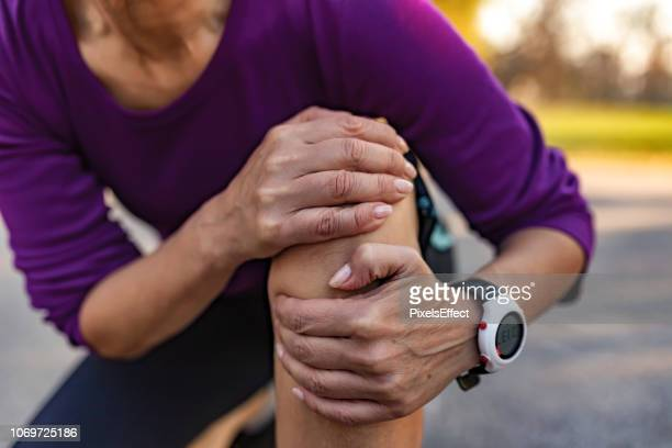 sometimes exercise can lead to injury - knee stock pictures, royalty-free photos & images