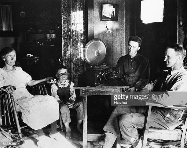 Sometimes the whole family gathered around the receiving set This Hood River County Oregon farm family is listening to the radio July 20 1925