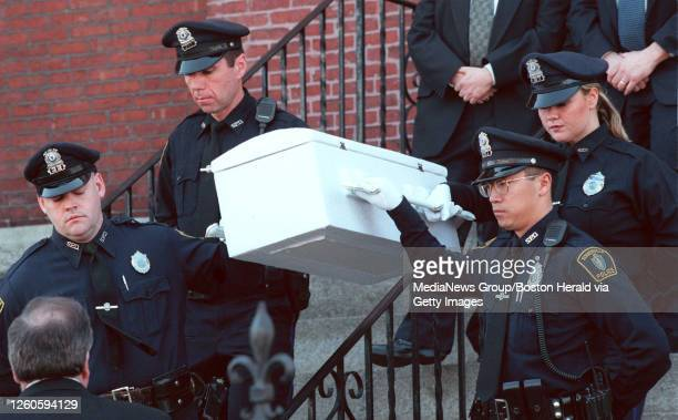Someville Police Officers Paul Duffy, Steven Carrabino,John Tam, Catherine McDaid carry the casket from services at St. Joseph's in Somerville. Saved...