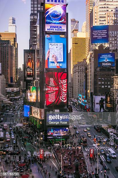 A somewhat crowed Times Square is viewed from the bar at the Marriott Marquis Hotel on October 21 2013 in New York City With a full schedule of...