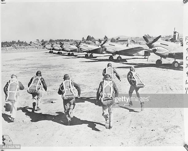 Running to Planes Enemy Approaching American Pursuit pilots streak for their P40s as an air raid warning is sounded It is their call to meet the Jap...