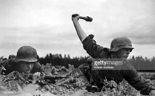 Somewhere on the Russian front a German soldier rears back to throw a Model 24 grenade popularly known as a 'stick grenade' or a 'potato masher'...