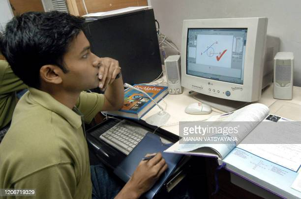 Somit Basak of Career Launcher works on his computer while tutoring online in New Delhi 24 July 2005 Career Launcher offers online tutoring and...