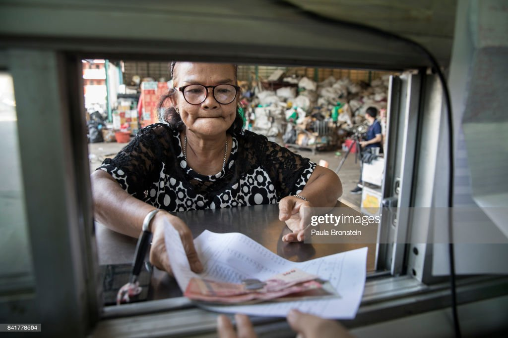 Somkit Klangpong, a retired worker makes double her pension bringing in recycle material on a weekly basis is seen getting paid at the Wongpanit Suvarnabhumi recycle collection center on September 1, 2017 in Bangkok, Thailand. People arrive at the recycling and sorting center with their products, plastic, metal, steel and paper. They are paid by weight according to the market cost. Plastic bottles can be recycled into Polyethylene Terephthalate (PET) bottle flakes and post consumer recycle (PCR) for the textile market IPI -NPT chips. Many plastic items like shopping bags, and food wrapping tend to be used for short periods before being discarded. A recent study stated that Thailand along with China, Indonesia, the Philippines and Vietnam are on the list of the world's top-five plastic polluters. Cleaning up plastic pollution in Thailand is a challenge due to cultural, infrastructure and environmental obstacles.