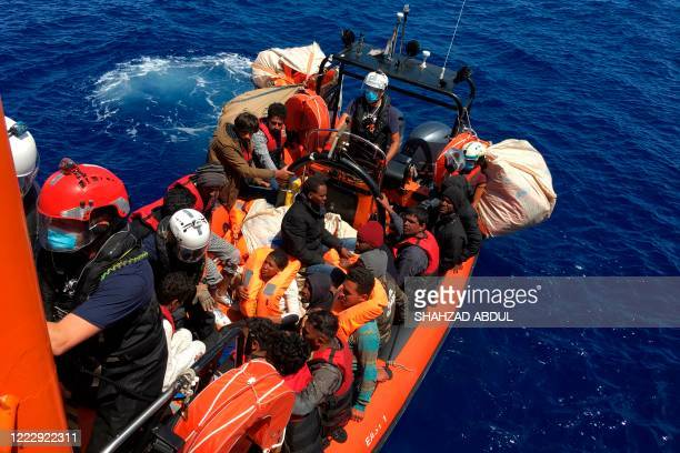 Somme of the 51 migrants, who were drifting on a wood boat, are rescued by members of French NGO SOS Mediterranee boat Ocean Viking, off the coast of...