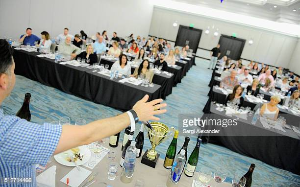 Sommelier Anthony Giglio speaks to guests during the Bank of America Lifestyle Seminar Uvaggio's Somm Slam hosted by Tanner Gill Heath Porter and...