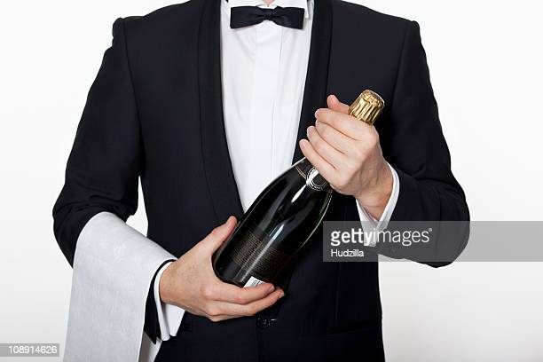 A sommelier holding a bottle of champagne