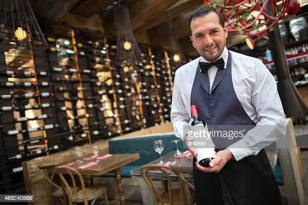 Sommelier holding a bottle of wine