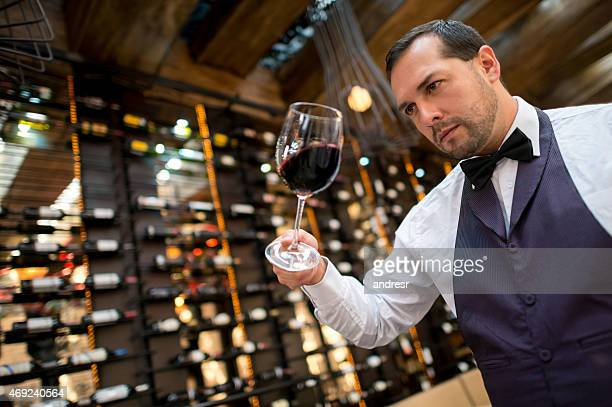 Sommelier holding a glass of wine