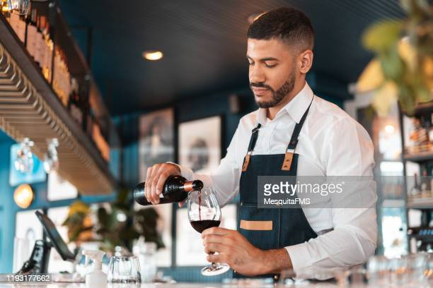 sommelier pouring wine in the wineglass - service stock pictures, royalty-free photos & images