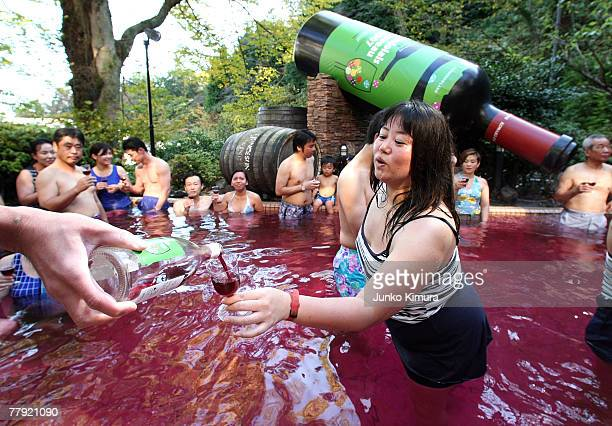 A sommelier pours a bottle of Beaujolais Nouveau to an open air wine spa at the Hakone Kowakien Yunessun on November 15 2007 in Hakone Kanagawa...