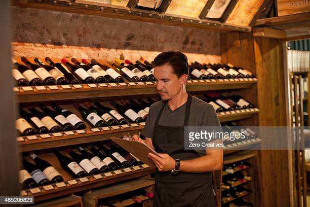 Sommelier stock taking in wine shop