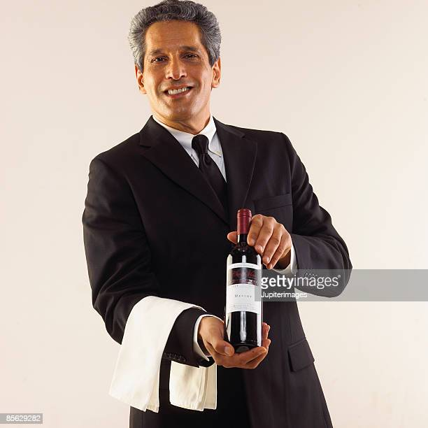 Sommelier with wine