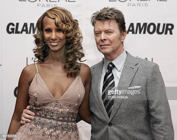 Somoliborn model Iman and her husband British musician David Bowie arrive 30 October 2006 for the 17th Annual Glamour Women of the Year awards at...