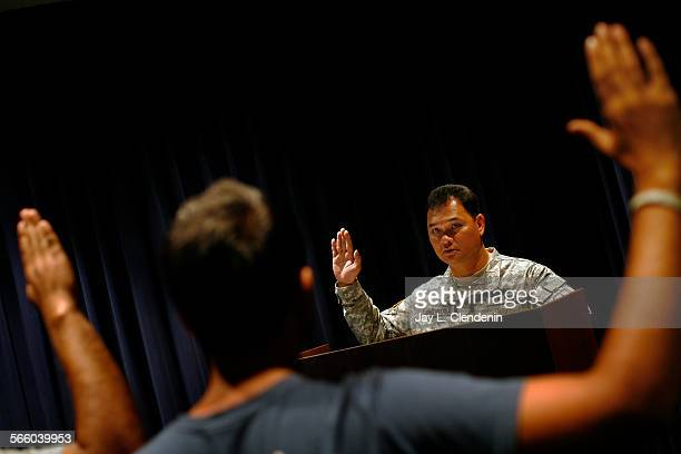EL SEGUNDO CA–– SEPTEMBER 3 2009––Somport Jongwatana Lt Col US Army Battalion Commander US Army Recruiting Batallion swears–in the 100th and 101st...
