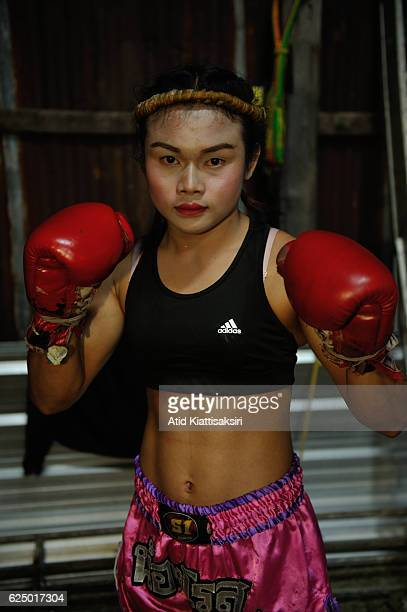 PAKCHONG NAKHONRATCHASIMA THAILAND Somros Pholcharoen Thai ladyboy Muay Thai boxer poses for a photograph before go to the ring for her Muay Thai...