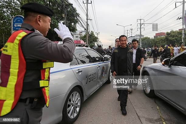 Somyot Poompanmoung, Lieutenant General of the Thai police, center, leaves the building where a suspect in the August 17 Bangkok shrine bombing was...