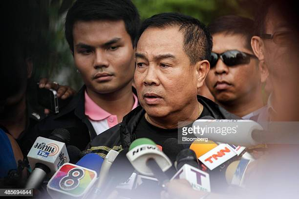 Somyot Poompanmoung, Lieutenant General of the Thai police, center, speaks to members of the media outside the building where a suspect of the August...