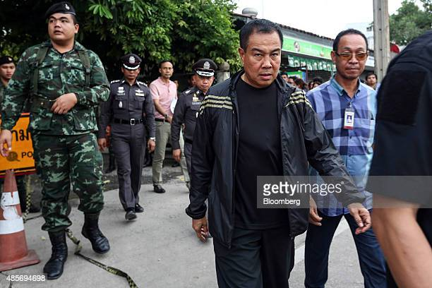 Somyot Poompanmoung, Lieutenant General of the Thai police, centre, leaves the building where a suspect in the August 17 Bangkok shrine bombing was...