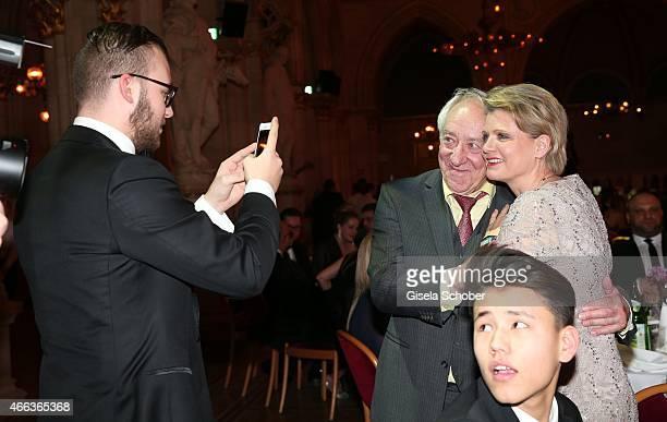 Son Alexander Spatzek photographs his mother Andrea Spatzek with Dieter Hallervorden during the Filmball Vienna 2015 on March 14 2015 in Vienna...