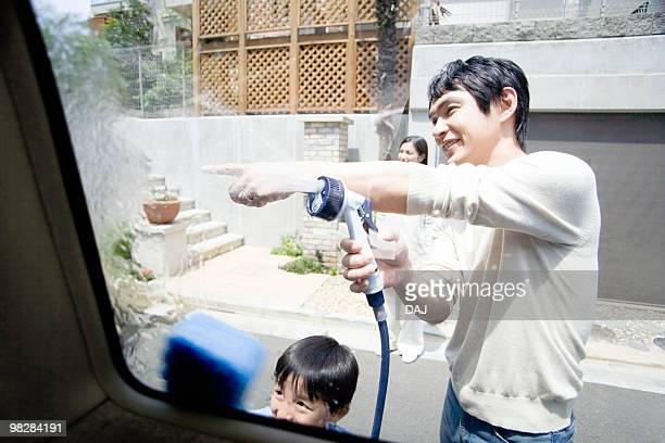 Son and Father Washing Car