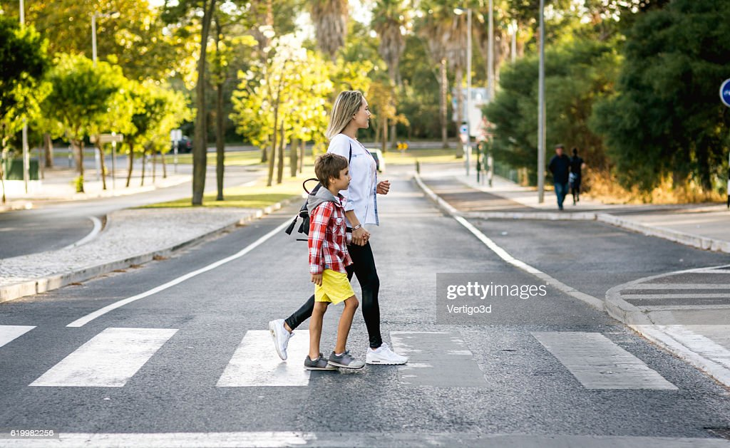 Son and Mom holding hands : Stock Photo