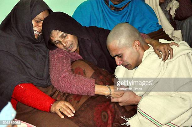 Son and wife of martyred soldier Havildar Jagdish Chand who was killed in Pathankot terror attack wail before his cremation at his native village on...