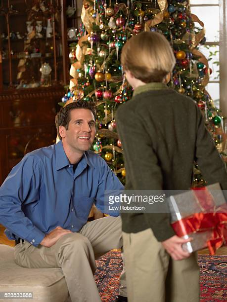 Son Bringing Christmas Present to Dad