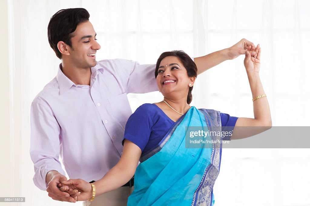 Son dancing with his mother : Stock Photo