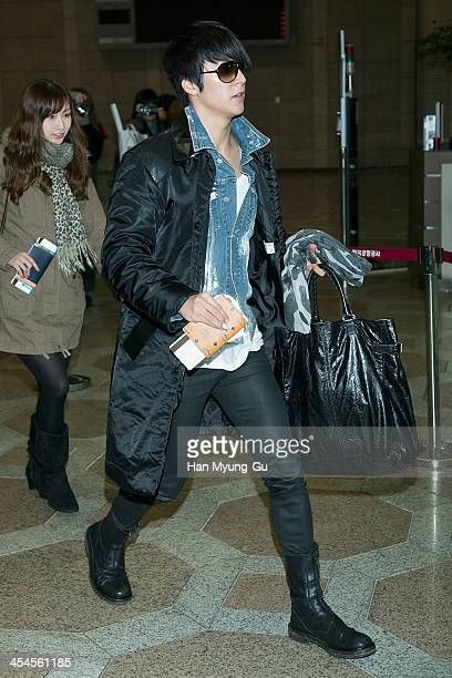 Son DongWoon of South Korean boy band Beast is seen on departure at Gimpo International Airport on December 9 2013 in Seoul South Korea