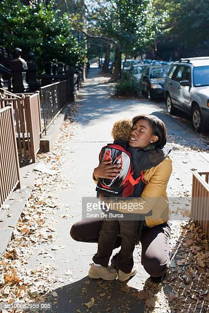 son (4-5) embracing mother, close-up - education stock pictures, royalty-free photos & images
