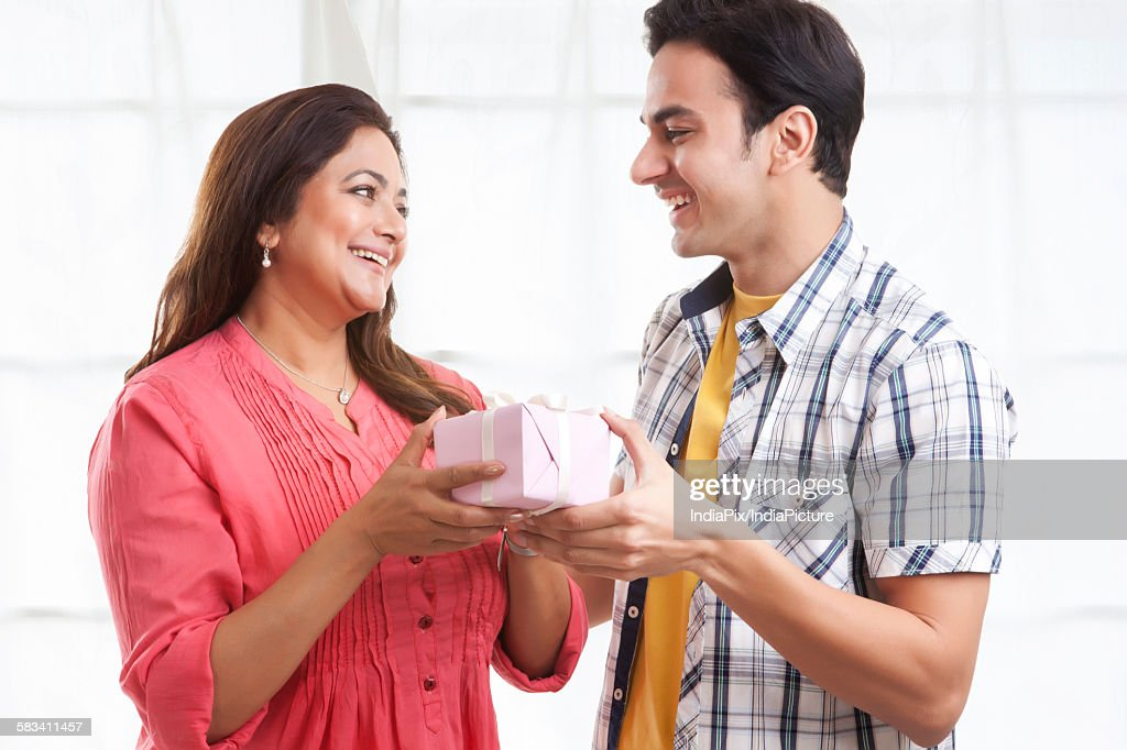 Son giving his mother a gift : Stock Photo
