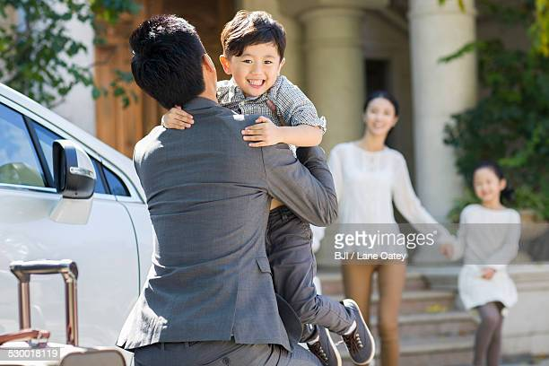 Son greeting returning father