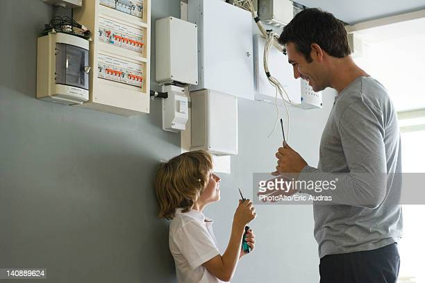 Son helping father with home improvement