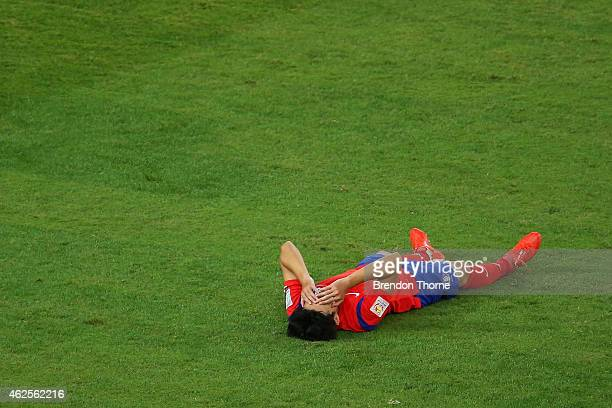 Son Heung Min of Korea Republic shows his dejection at full time following the 2015 Asian Cup final match between Korea Republic and the Australian...