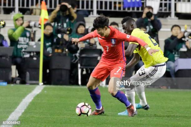 Son Heung Min of South Korea and Davinson Sanchez of Colombia in action during an KEB HANA BANK Invitational Friendly Match South Korea v Colombia at...