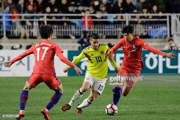 Son Heung Min of South Korea and James Rodriguez of Colombia in action during an KEB HANA BANK Invitational Friendly Match South Korea v Colombia at...