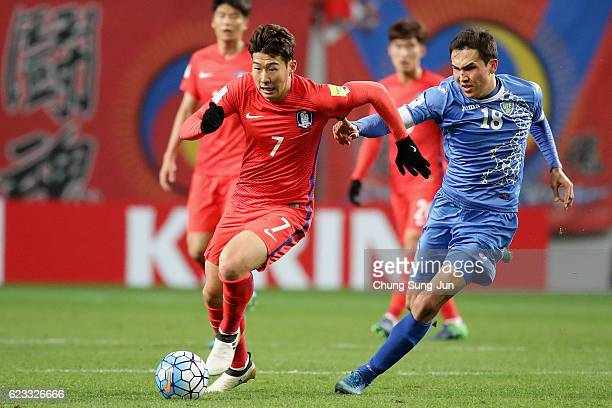 Son Heung Min of South Korea and Shukurov Otabek of Uzbekistan compete for the ball during the 2018 FIFA World Cup qualifying match between South...
