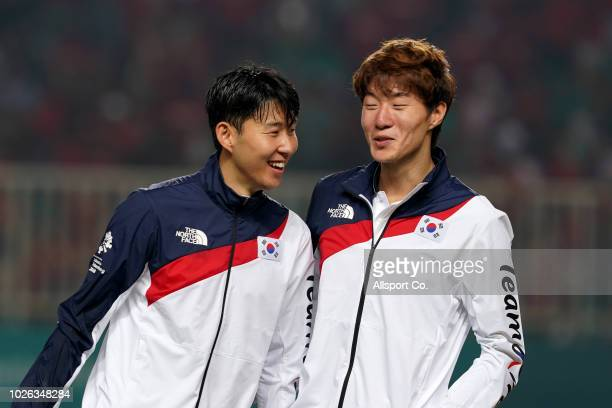 Son Heung Min of South Korea celebrates with Hwang Ul Jo after their defeated Japan 21 in extra time during the Men's Football gold medal match...
