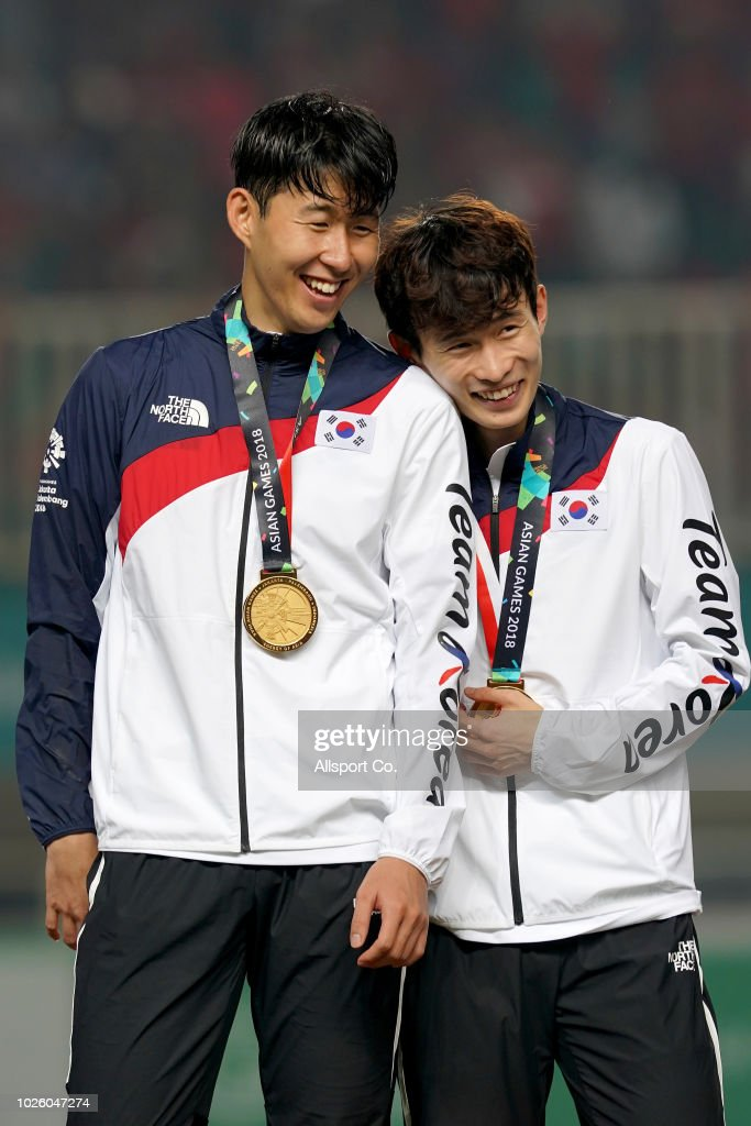 Son Heung Min of South Korea celebrates with Kim Moonhwan after their defeated Japan 2-1 in extra time during the Men's Football gold medal match between South Korea and Japan at the Pakan Sari Stadium on day fourteen of the 18th Asian Games on September 1, 2018 in Jakarta, Indonesia.