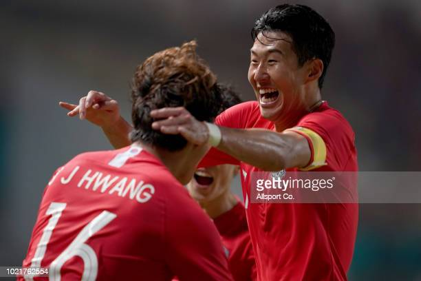 Son Heung Min of South Korea congratulates teammate Hwang Ui Jo after the later scored their first goal against Iran during the Men's football...