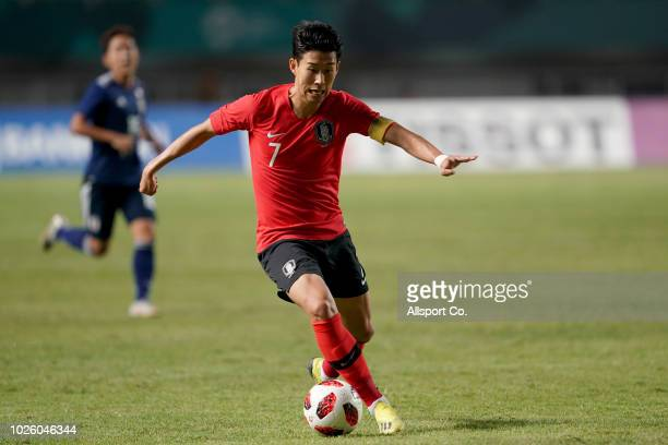 Son Heung Min of South Korea in action during the Men's Football gold medal match between South Korea and Japan at the Pakan Sari Stadium on day...