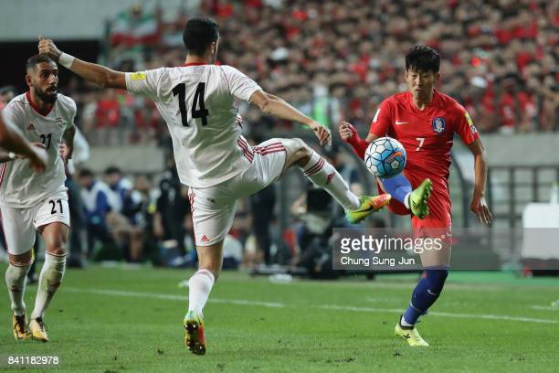 Son Heung Min of South Korea takes on Ali Karimi of Iran during the FIFA World Cup Russia Asian qualifier match between South Korea and Iran at Seoul...