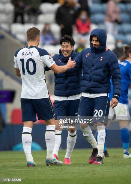 Son Heung-Min and Dele Alli of Tottenham Hotspur celebrate with team mate Harry Kane at the final whistle during the Premier League match between...