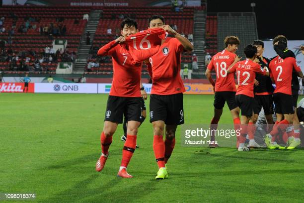 Son Heungmin and Ji Dongwon of South Korea hold the jersey of Ki Sungyueng when second goal of South Korea during the AFC Asian Cup round of 16 match...