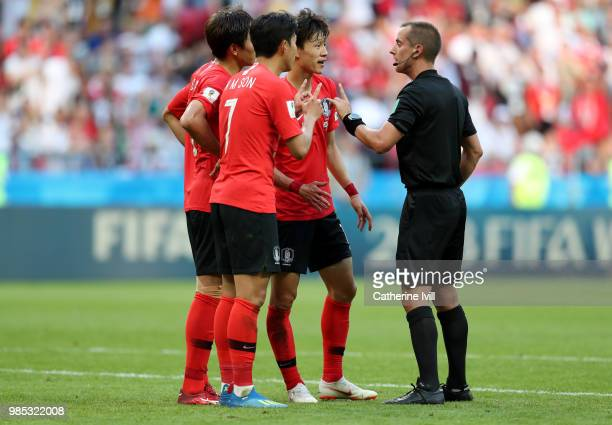 Son HeungMin and Yun YoungSun of Korea Republic complain to referee Mark Grieger after he disallowed a goal which was then allowed following a VAR...
