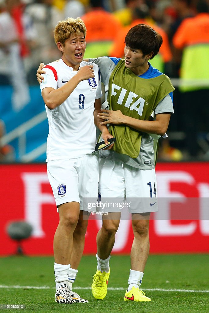 Son Heung-Min is consoled by Han Kook-Young of South Korea after a 0-1 defeat to Belgium in the 2014 FIFA World Cup Brazil Group H match between South Korea and Belgium at Arena de Sao Paulo on June 26, 2014 in Sao Paulo, Brazil.