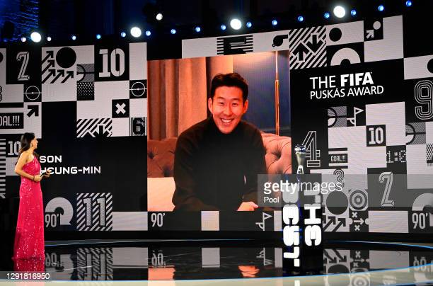 Son Heung-min is seen giving a acceptance speech on a video link after winning the FIFA Puskas Award as Reshmin Chowdhury looks on during the The...